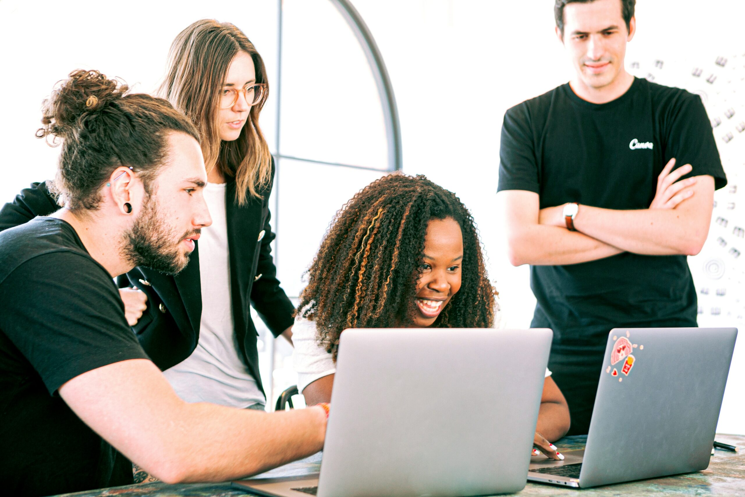 Team of coworkers searching online